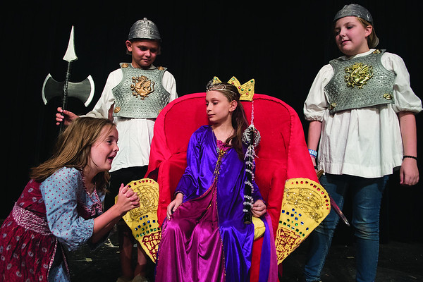 Skylark Watkins, 9, Hagen Hassell, 9, Kylaney Breen, 9, and Ella Frisinger, 10, stage a scene from their play during the Thespians 'N Training theater arts camp held at the Cherokee Civic Theatre in downtown Rusk Wednesday July 26, 2017. The young campers have 40 hours to audition, rehearse, organize costumes and props and build sets to produce a one-act show. The plays will be performed for the public July 29.  (Sarah A. Miller/Tyler Morning Telegraph)