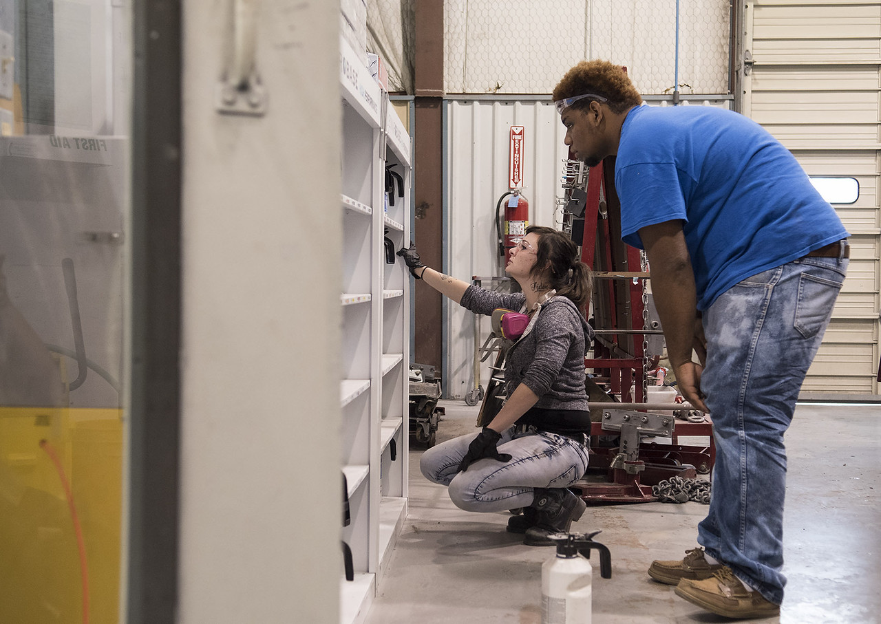 Brittany Casanova and Lance Daniel pick out paint for their auto repairs during class at Kilgore College's auto body shop Monday May 17, 2017.  (Sarah A. Miller/Tyler Morning Telegraph)