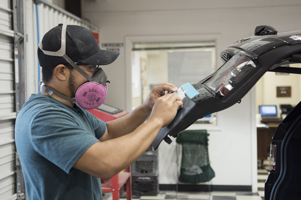 Student Humberto Delarosa sands a damaged area on a vehicle during class at Kilgore College's auto body shop  Monday May 17, 2017.  (Sarah A. Miller/Tyler Morning Telegraph)