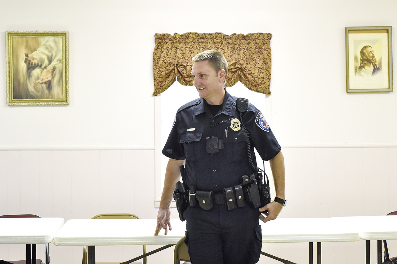 Officer Darrell Gardner smiles during a community meeting at St. James Missionary Church in Tyler, Texas, on Tuesday, May 30, 2017. Gardner has worked the same beat for over 18 years. He has established a relationship with the citizens who call him directly when things are not right in their neighborhoods. (Chelsea Purgahn/Tyler Morning Telegraph)