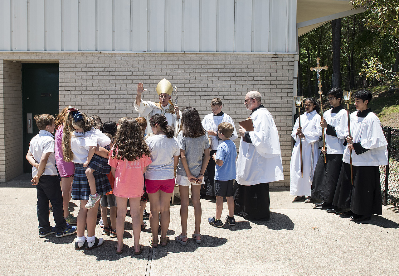 Most Rev. Joseph E. Strickland, Bishop of the Diocese of Tyler, is surrounded by St. Gregory students as he blesses the ground for the Brodnax Family Crusader Center at Bishop Thomas K. Gorman Cathedral School. The 4.9 million dollar multi-purpose building will replace the existing field house. It will house locker rooms, a weight room, an area for drill, dance and cheer teams and to view films.   (Sarah A. Miller/Tyler Morning Telegraph)