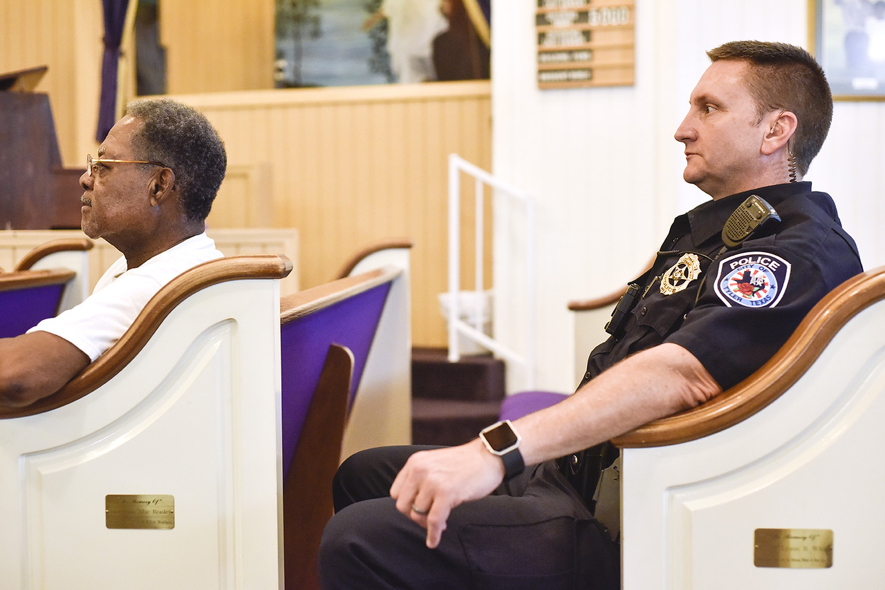 Officer Darrell Gardner listens during a community meeting at Smith Temple Church of God in Tyler, Texas, on Tuesday, May 30, 2017. Gardner has worked the same beat for over 18 years. He has established a relationship with the citizens who call him directly when things are not right in their neighborhoods. (Chelsea Purgahn/Tyler Morning Telegraph)