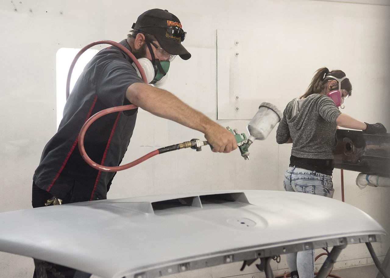 Mickey Nolen sprays primer onto an Edsel hood during class at Kilgore College's auto body shop Monday May 17, 2017.  (Sarah A. Miller/Tyler Morning Telegraph)