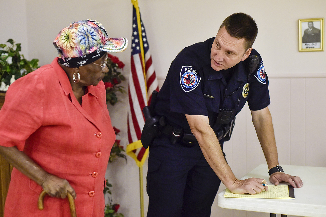 Josephine Hayden speaks with Officer Darrell Gardner during a community meeting at St. James Missionary Church in Tyler, Texas, on Tuesday, May 30, 2017. Gardner has worked the same beat for over 18 years. He has established a relationship with the citizens who call him directly when things are not right in their neighborhoods. (Chelsea Purgahn/Tyler Morning Telegraph)