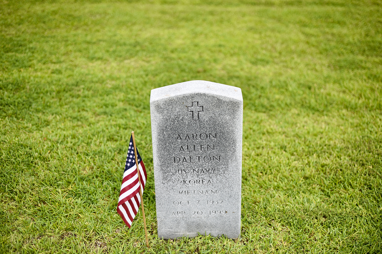 An American flag placed next to a veteran's tombstone for the annual Memorial Day flag ceremony at Chandler Memorial Cemetery in Chandler, Texas, on Monday, May 29, 2017. Names of World War I veterans who rest in the cemetery were read and honored. (Chelsea Purgahn/Tyler Morning Telegraph)