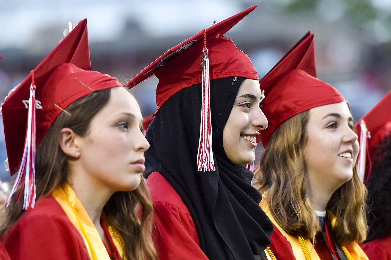 Yasmeen Khalifa, center, smiles during Robert E. Lee High School's graduation ceremony at Trinity Mother Frances Rose Stadium in Tyler, Texas, on Friday, June 2, 2017. Thousands of friends and family members came to see the hundreds of seniors walk the stage for graduation. (Chelsea Purgahn/Tyler Morning Telegraph)