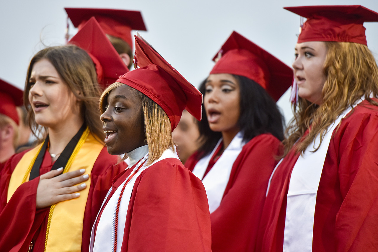 Choir members sing the national anthem during Robert E. Lee High School's graduation ceremony at Trinity Mother Frances Rose Stadium in Tyler, Texas, on Friday, June 2, 2017. Thousands of friends and family members came to see the hundreds of seniors walk the stage for graduation. (Chelsea Purgahn/Tyler Morning Telegraph)