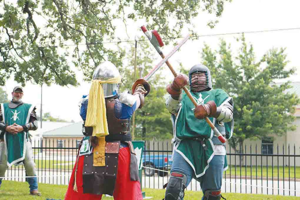 Above, Members of the Shire Of Oakwood Knights, a midieval re-enactment group, battle it out in front of the crowd during the second annual Tyler Celtic Festival on the grounds of the Goodman-LeGrand House & Museum on Saturday. (Schuyler Wick/Staff)