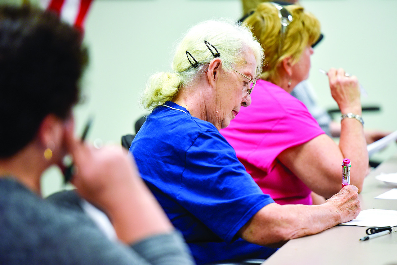 East Texas Writers Guild member Pat La Vigne takes notes during a East Texas Writers Guild meeting at the Tyler Area Chamber of Commerce on Monday, May 8, 2017. Multi-published author James R. Callan spoke to the group about writing dialog. (Chelsea Purgahn/Tyler Morning Telegraph)