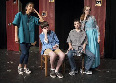 Karsyn Cunningham, 12, Sage Breen, 13, Raymond Arrington, 12, and Annagrace Tucker, 13, stage a scene from their play during the Thespians 'N Training theater arts camp held at the Cherokee Civic Theatre in downtown Rusk Wednesday July 26, 2017. The young campers have 40 hours to audition, rehearse, organize costumes and props and build sets to produce a one-act show. The plays will be performed for the public July 29.  (Sarah A. Miller/Tyler Morning Telegraph)