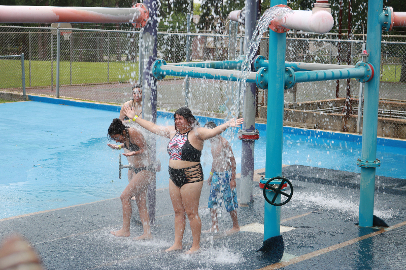 People enjoy the sprayground at Fun Forest pool on Saturday, the first day the facility opened for the summer season. (Schuyler Wick/Staff)