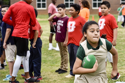Christina Ochoa, 10, runs with the football during Sports Day hosted by Robert E. Lee students at Douglas Elementary School in Tyler, Texas, on Friday, May 19, 2017. The event was organized in part by teacher Mrs. Jones and her son Royland Black as a way to motivate and reward students for their hard work at the end of the school year. (Chelsea Purgahn/Tyler Morning Telegraph)