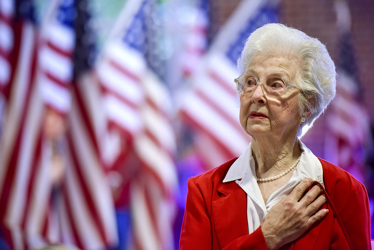 Louise Waren holds her hand to her heart during the national anthem at a sendoff for the annual Brookshire's honor flight at Tyler Pounds Regional Airport in Tyler, Texas, on Monday, May 29, 2017. The veterans will travel to Washington D.C. to visit the World War II Memorial, as well as several other points of interest. (Chelsea Purgahn/Tyler Morning Telegraph)