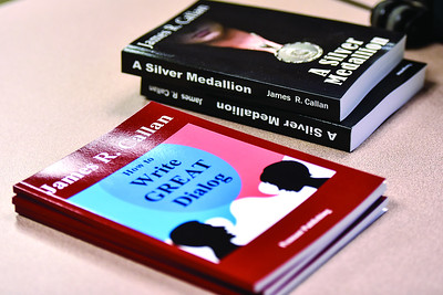 Some of James R. Callan's books are photographed during a East Texas Writers Guild meeting at the Tyler Area Chamber of Commerce on Monday, May 8, 2017. Callan spoke to the group about writing dialog. (Chelsea Purgahn/Tyler Morning Telegraph)