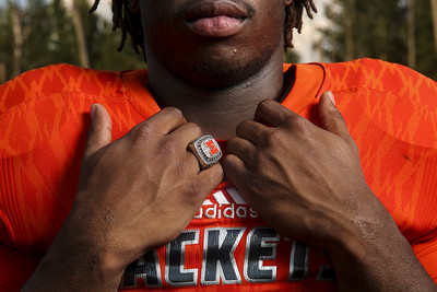 Mineola's Curtis London poses for a portrait with his state championship ring at Mineola Nature Preserve in Mineola, Texas, on Friday, Aug. 4, 2017. (Chelsea Purgahn/Tyler Morning Telegraph)