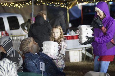 Hundreds of volunteers helped serve 650 meals during Hunger for Love's 7th Annual Christmas Under the Bridge on Saturday, Dec. 16, 2017 in Tyler, Texas. (Cory McCoy/Staff)