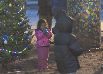 Children played while the adults set up for Hunger for Love's 7th Annual Christmas Under the Bridge on Saturday, Dec. 16, 2017 in Tyler, Texas. (Cory McCoy/Staff)