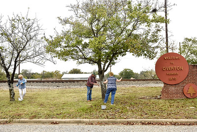 Debbie Poole, Dan Browder and LeAnn Bazar hang string lights in Overton, Texas, on Wednesday, Nov. 15, 2017. The town will light up their downtown with lights during the holiday season for the first time in years. (Chelsea Purgahn/Tyler Morning Telegraph)