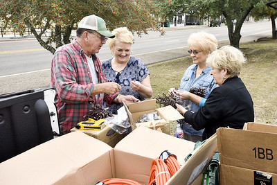 Dan Browder, LeAnn Bazar, Debbie Poole and Cecelia Sanders organize strings of lights in Overton, Texas, on Wednesday, Nov. 15, 2017. The town will light up their downtown with lights during the holiday season for the first time in years. (Chelsea Purgahn/Tyler Morning Telegraph)