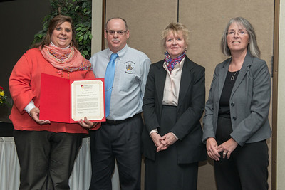 Distinguished Staff DeeDee Stakley with Craig Bowman, Pam Muccio and Shelly VandePanne.