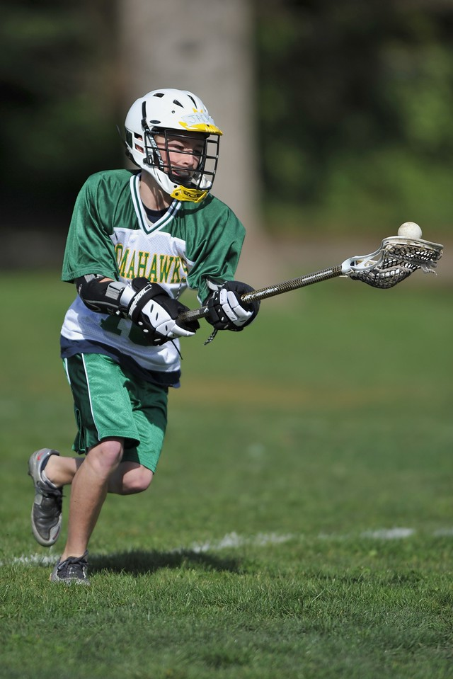 """<B>Youth Sports.</B>  I have extensive experience shooting professional, Division I collegiate, and youth sports (see galleries for both individual and team sports).  I offer packages to shoot individual athletes, teams, and multi-team tournaments.   For individuals, I will focus only on one athlete for the duration of the game or event and provide a wide variety of action and candid images from which to choose.  There will be an up-front session fee at $75/hr.  Depending on the athlete's involvement and the length of the game or event, typically well over 100 high-quality images will be posted for review in a private, password-protected, online gallery.  The client, family, and friends can then purchase prints at reasonable rates.  Please inquire for further details.  For multi-team tournaments, I can provide images for digital download  at $10 per image with unlimited rights to reproduce and distribute, with a percentage of all sales reserved for the league.  For teams, I can cover the entire team's action for a given game or event.  Session fees for team coverage are $125/hr.  Images for all youth sports engagements will be posted for review within 48 hours of the event, with most typically posted within 12 hours.  <a href=""""mailto:daniel@backstopimages.com"""">daniel@backstopimages.com</a>"""