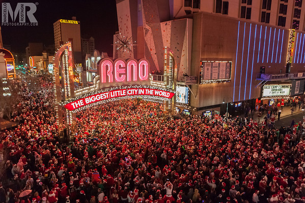 Reno Photographer Marcello Rostagni photographs the Santa Crawl event in downtown Reno.