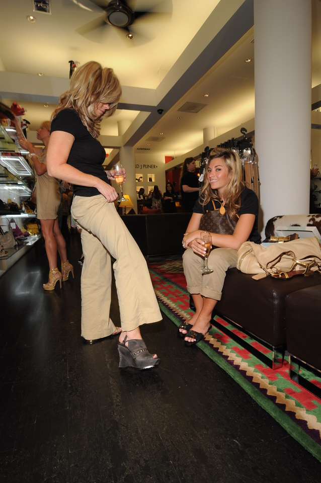 Debbie Weatherford and Lynda Fuchs Trying on Shoes