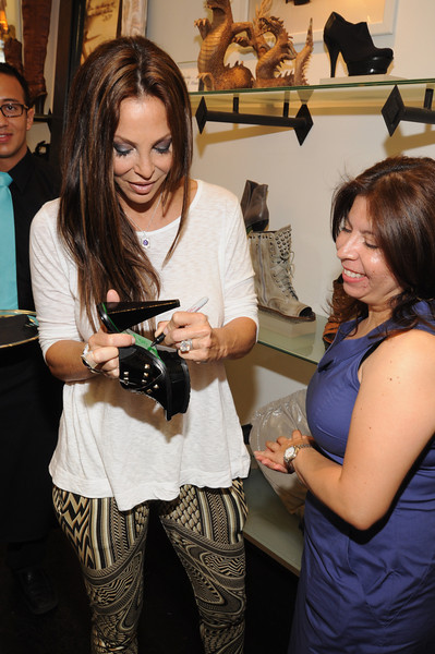 Lisa signing her designer shoes for Elizabeth Lopez