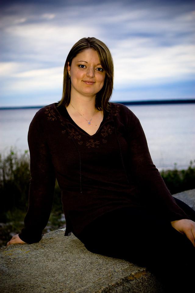 Shanin at Devin wedding, sitting on the breakwater.
