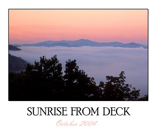 This photo was taken at sunrise during October 2004.  It is the only time (during the past year) that I have seen the combination of the clouds in the valley and the early morning light so intense.  I awoke from the loft to see the beautiful sunrise through the sky window.
