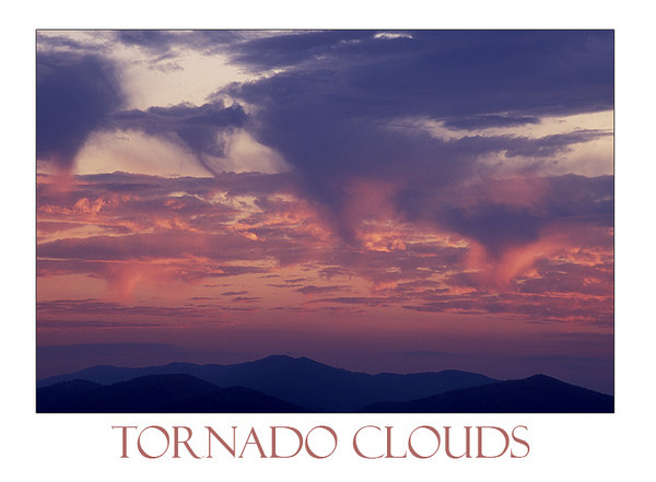 "This photo is named ""Tornado Clouds"" because the clouds closely resemble small funnels. This particular evening in early Spring 2006 made for some wonderful cloud formations.  I'm always eager to sit on the deck in the late evening hours to see what type of fantastic sky the sun and clouds will serve up."