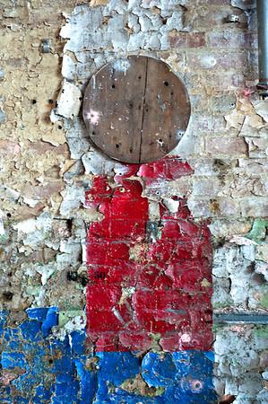 Peeling Paint and Wooden Wheel