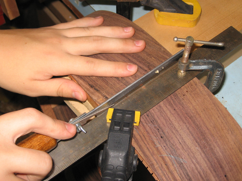 Cutting the slot for the tail piece decoration.