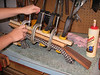 Clamping the fingerboard in place.