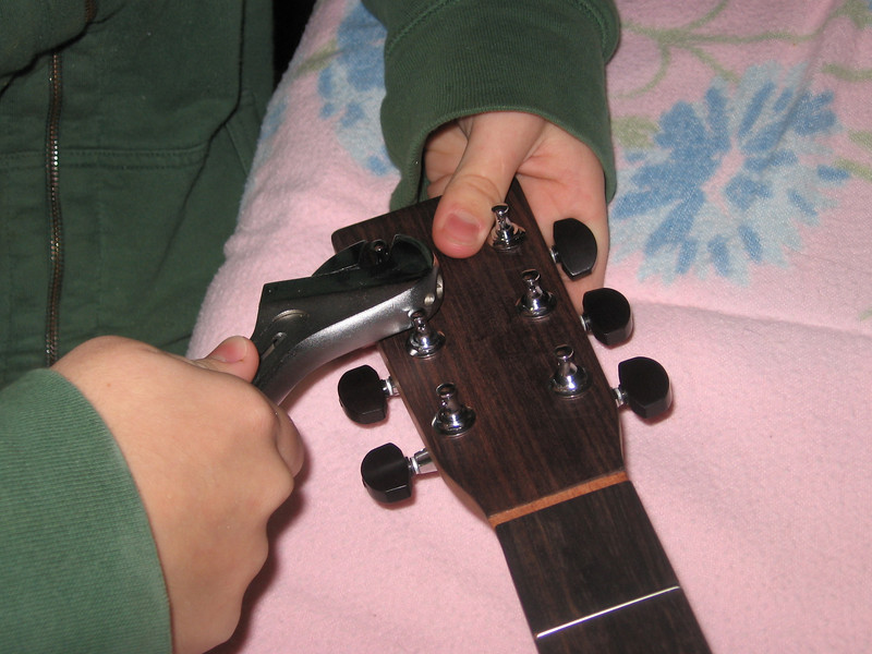 Installing the tuning machines.