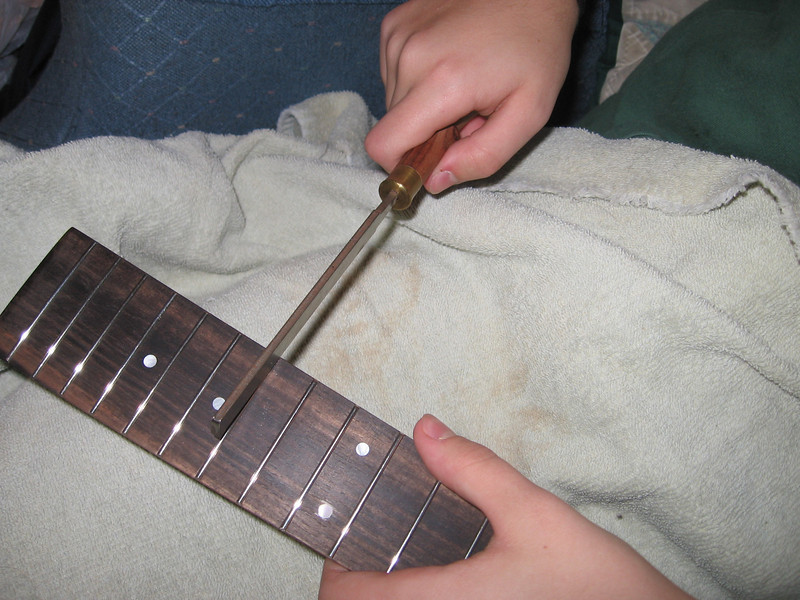 Finish filing with a fret file.
