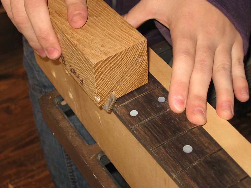 Using and angled fret edge block to get the correct angle.