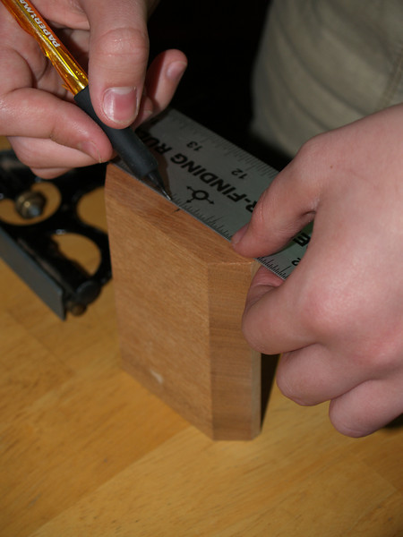 Marking the center line on the tail block. Everything is measured and built from the center line.