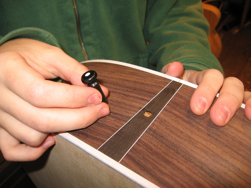 Installing the tail pin after the hole has been tapered with a tapered reamer.