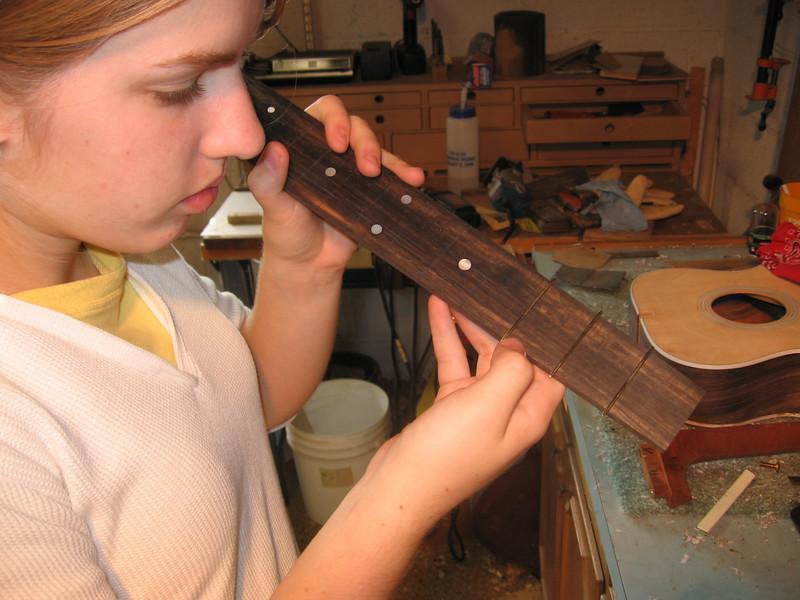 Making sure the frets sit flat.