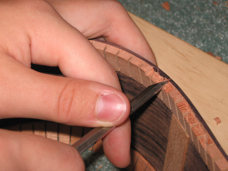 Notching the kerf-ribbon lining to receive the braces.