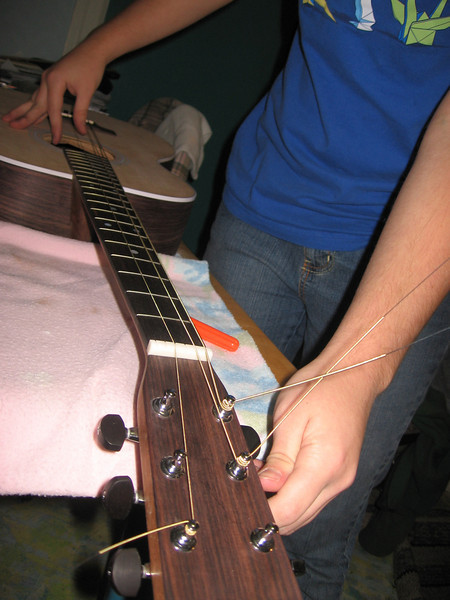 Stringing up guitar prior to grad. project demo.