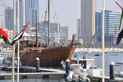 Sheik Sultan's fighting dhow docked outside the aquarium.  Sharjah city in the background.
