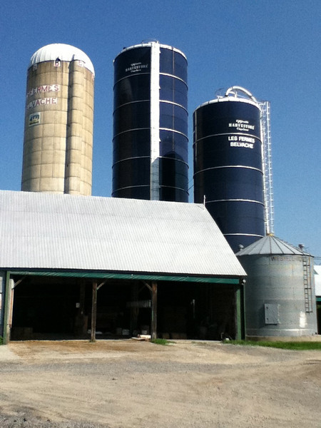 "The silos rising above the barn are feed silos at the Organic farm in Montreal ""Les Fermes Belvache"""