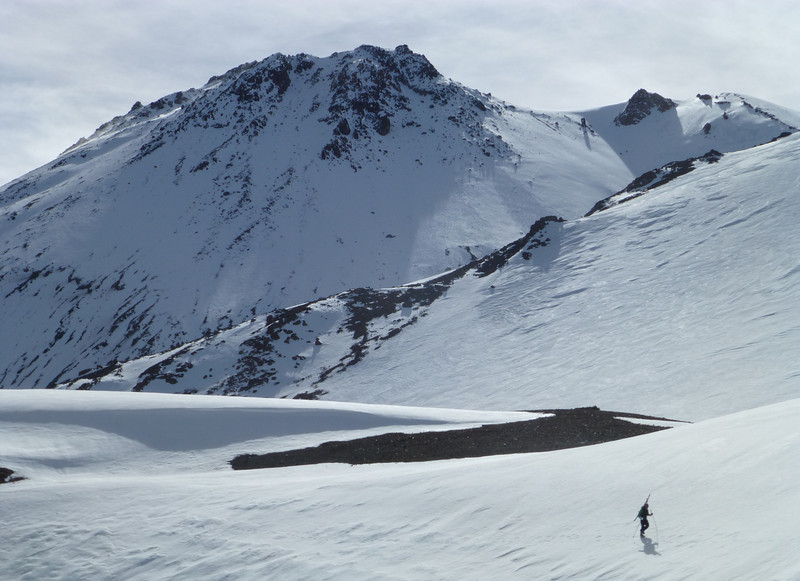 Shasta-Shastina saddle in the foreground with skier (Rick) walking across.  Shasta summit in the background.