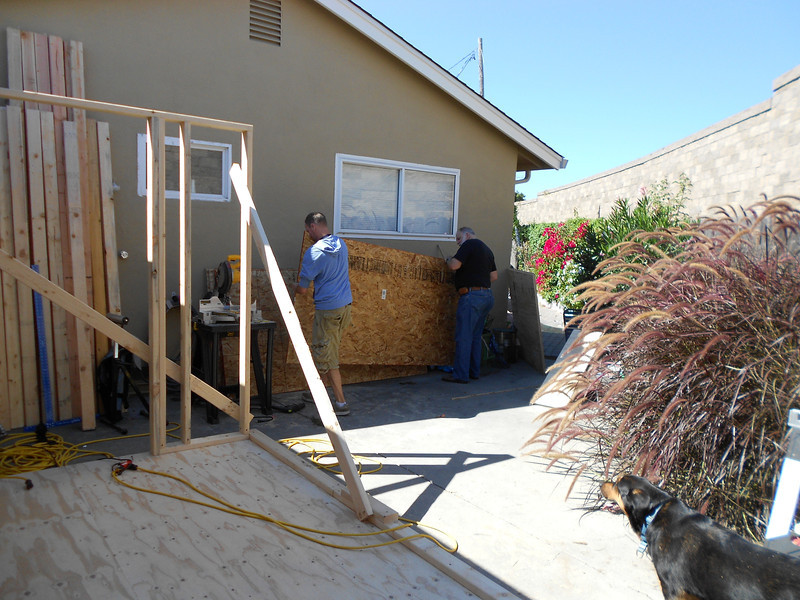 Douglas and Dad got the floor and part of a wall framed--now John and Stan help with the rest of the framing
