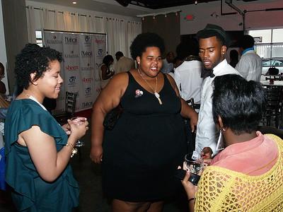 (C) Holly Clay, Editor of Sheen Magazine chatting with guests.