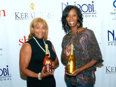 Kimberly Chapman, Co-Founder of Nairobi Professional Products, Publisher of Sheen Magazine and Founder of The Chapman Foundation pictured with her friend, Monique Evans, Founder of The Children's Pride Foundation.