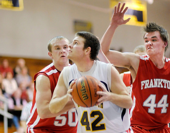 Shenandoah's Terick Warner looks to shoot from the low post as he is guarded by Frankton's Logan Weins (50) and Isaac Stuckey as the Raiders hosted the Eagles on Saturday.