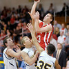 Frankton's Aaron Korn shoots over Shenandoah's Terick Warner, Lane Young and Moose Kirk as the Raiders hosted the Eagles on Saturday.